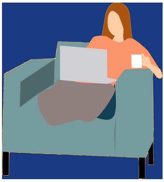 woman on sofa watching laptop