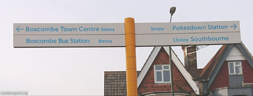 colour photo of sign at top of Parkwood Road which points to Boscombe Town centre to the left, and Pokesdown Station to the right