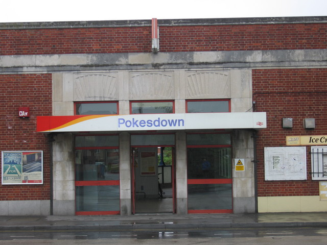 colour photo of Pokesdown Station sign at entrance in 2001