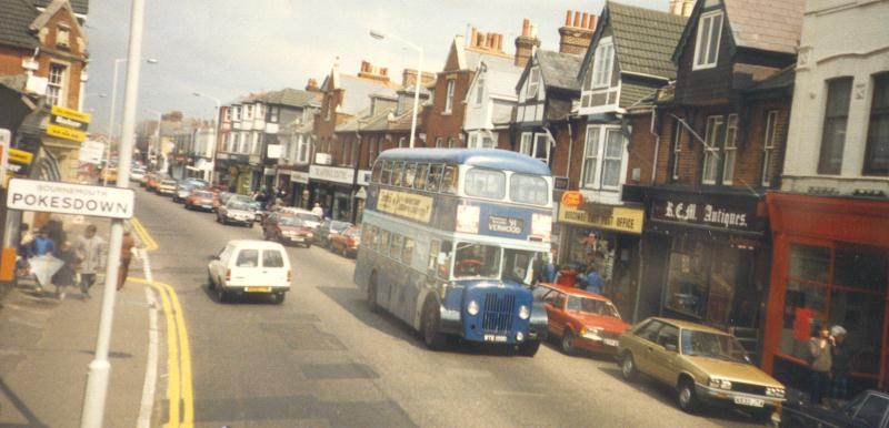 colour photo of a blue bus driving along Christchurch Road, Pokesdown, late 1980s