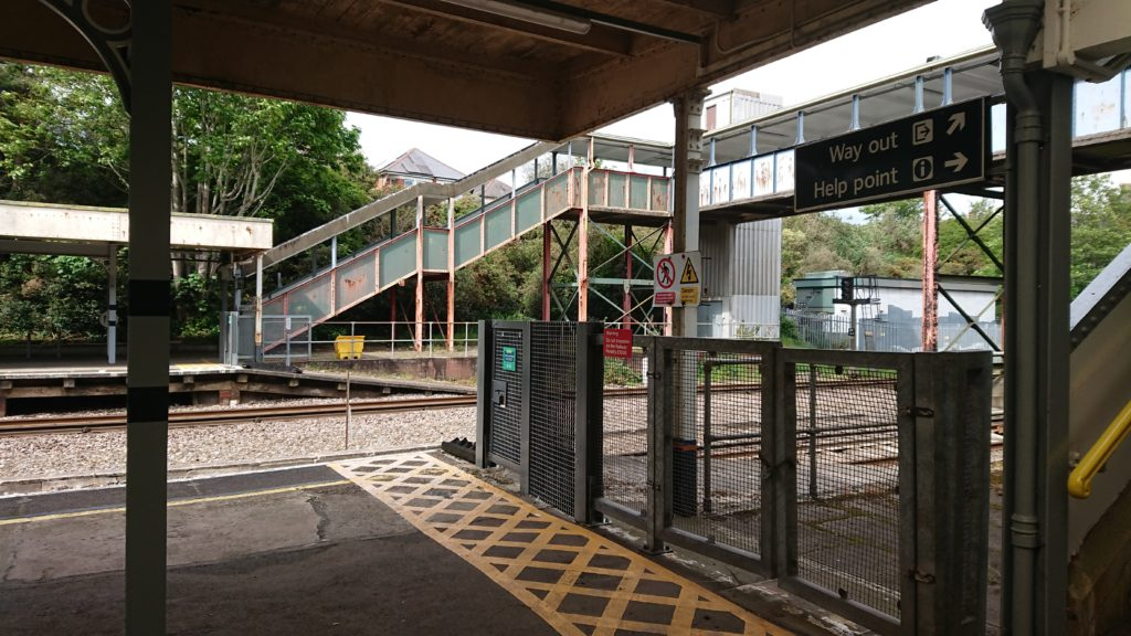 colour photo of modern day steps up from Pokesdown Station platform to the footbridge